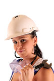 Young woman with hard hat and tools. On white background Royalty Free Stock Photo