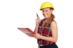 Young woman with hard hat and writing board Royalty Free Stock Photos