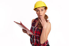 Young woman with hard hat and writing board Stock Images