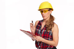 Young woman with hard hat and writing board Stock Image