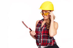 Young woman with hard hat and writing board Royalty Free Stock Image