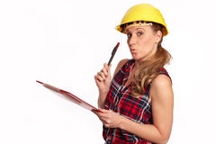 Young woman with hard hat and writing board Stock Photo