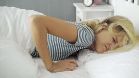 Young woman hardly waking up in morning, sleep schedule