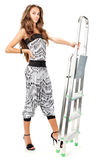 Young woman in harem pants posing with step-ladder Royalty Free Stock Images