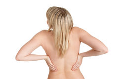 Young woman has back pain. Beautiful young blond woman has back pain royalty free stock photo