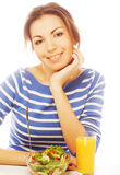 Young woman has breakfast Stock Photo