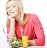 young woman has breakfast salad Stock Photo