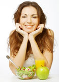 young woman has breakfast salad Royalty Free Stock Photos