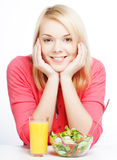 young woman has breakfast salad Royalty Free Stock Images