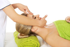 Young woman has face massage. Stock Photography