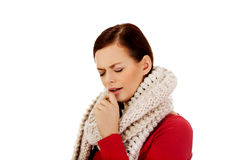 Young woman has a flu. Coughing Stock Photo