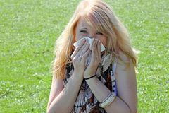 A young woman has hay fever Royalty Free Stock Image