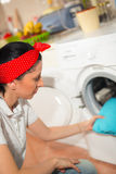 Young woman has a laundry day at home Stock Photo