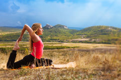 Young woman has outdoor yoga practice Stock Photo