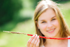 Young woman has picked wild strawberries to straw Royalty Free Stock Image