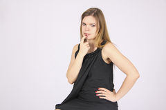 Young woman has question Royalty Free Stock Photo