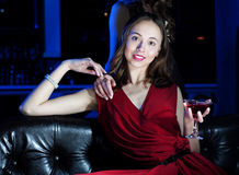 Young woman has a rest with an alcoholic drink Royalty Free Stock Photography