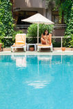 Woman has a rest on at swimming pool Stock Image