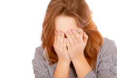 Young woman has shut face with hands Stock Image
