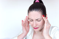 How to cure a headache. A young woman has a strong headache and holding his head, photography Royalty Free Stock Images