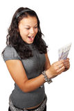 Young woman has won a lot of money. Surprised young woman received british pounds Stock Image