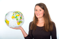 Young woman has the world in her hands Stock Photos