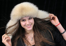 Young woman in hat Stock Images