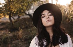 Young woman in hat on autumn day stock images