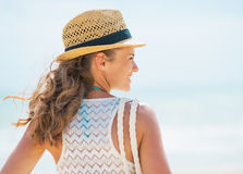 Young woman in hat and with bag on beach. rear view Royalty Free Stock Images
