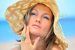 Young woman with hat on the beach Stock Image