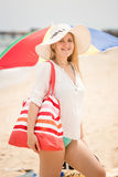 Young woman in hat with beach bag posing at sea Royalty Free Stock Images