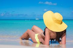 Young woman in hat on the beach enjoy caribbean Stock Images