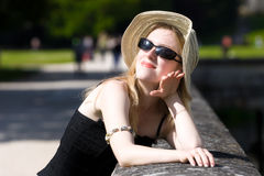 Young woman in hat enjoy the sun.  Royalty Free Stock Photography