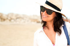 Young woman with hat enjoying the beach while on holiday Royalty Free Stock Images