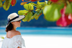 Young woman with a hat enjoying summer at the beach Stock Photos