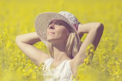 Young woman with a hat enjoying summer on the field. Young woman with a hat enjoying summer on the field stock images