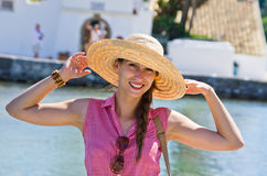 Young woman in hat enjoying vacation time Royalty Free Stock Photography