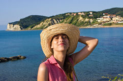 Young woman in hat enjoying vacation time Stock Photo