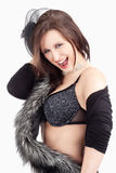 Young Woman with Hat and Fur in her Bra, Smiling Royalty Free Stock Images