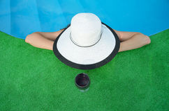 Young woman in a hat and a glass of red wine, top view. Stock Photo