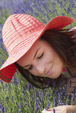 Young woman with hat in a lavender garden Royalty Free Stock Images