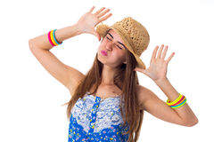 Young woman in hat making faces Royalty Free Stock Photos