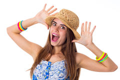 Young woman in hat making faces Stock Images