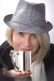 Young woman with a hat and a metallic cup Royalty Free Stock Photos
