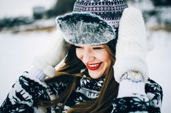 Young woman in hat and mittens. Portrait of handsome young woman wearing warm hat and mittens in winter Royalty Free Stock Photos
