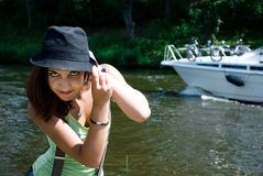 Young woman in hat near the river Stock Photography