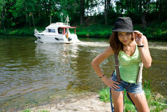 Young woman in hat near the river Royalty Free Stock Images