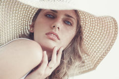 Young woman in a hat portrait Stock Images