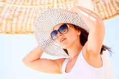 Young woman in a hat Stock Images
