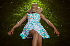 Young woman with hat relaxing in park Royalty Free Stock Photos